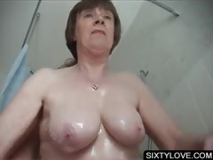 Mature gets snatch washed in..